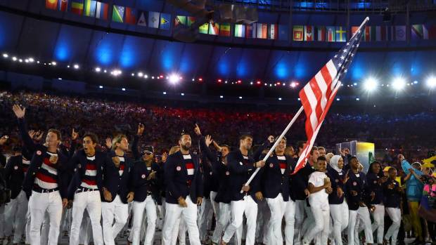 Flag-bearer Michael Phelps (USA) of United States of America leads his contingent during the opening ceremony.