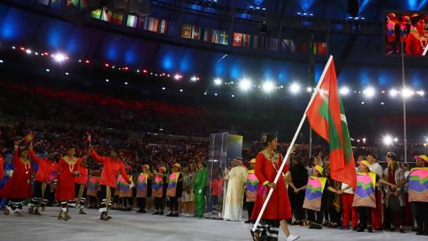 Flagbearer Aminath Shajan (MDV) of Maldives arrives for the opening ceremony.