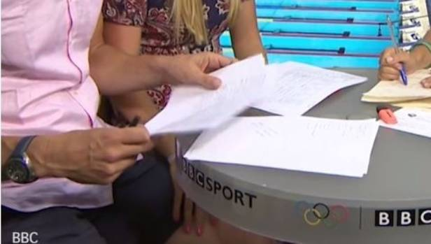 Adlington appears to rest her hand on Foster's thigh.