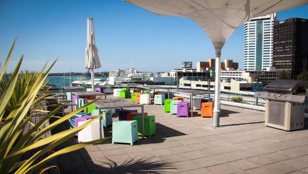 Outdoor seating and barbecue area on the top of IAG's building in Auckland.