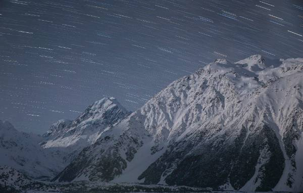 The Hooker Valley under moonlight with Aoraki/Mt Cook, left, and Mt Wakefield.