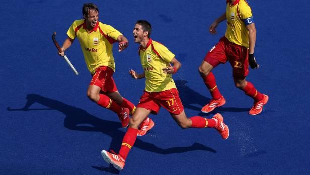 Xavi Lleonart (centre) celebrates with Bosco Perez-Pla (left) after his last-minute match-winning goal against the Black ...