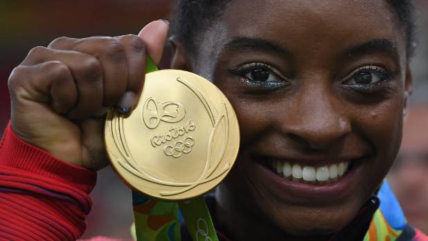 The triumphs of US athletes such as gymnast Simone Biles has  helped remind Americans of what they are capable of as a ...