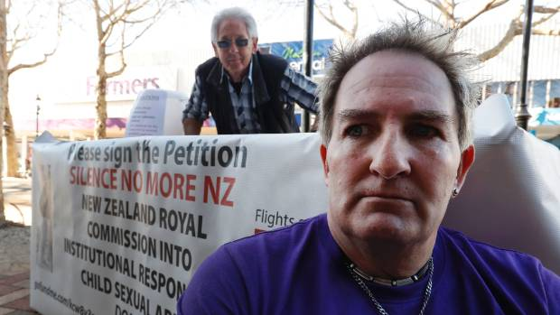 Grant West, right and supporter Pete Chapman are collecting signatures calling for a Royal Commission into institutional ...