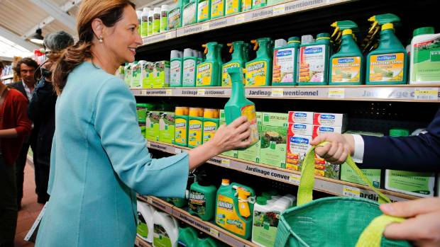 French Environment and Energy Minister Segolene Royal symbolically removes Monsanto's Roundup weedkiller atomizers from ...