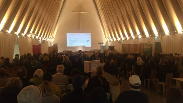 Hundreds of homeowners who are still battling EQC showed up to a meeting in the Transitional Cathedral on Thursday night.