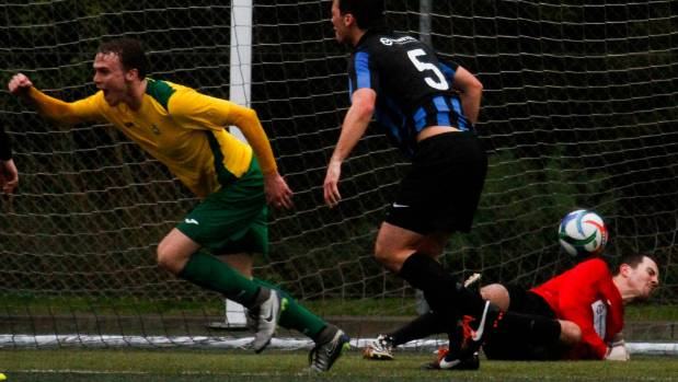 Lower Hutt's Taylor Schrijvers heads the ball past Dan Clarke to equalise against Miramar Rangers.