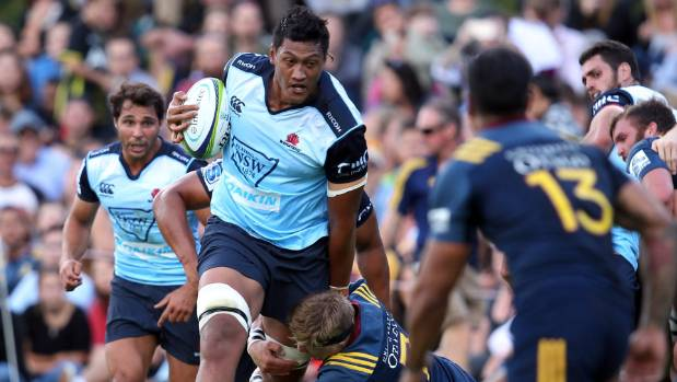 Sam Lousi busts through a Highlanders player's tackle while playing for the Waratahs in a preseason game in February.