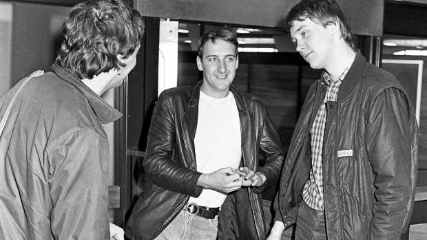 Fall guitarist Craig Scanlon, left, Marc Riley, and drummer Paul Hanley after arriving at Christchurch Airport.