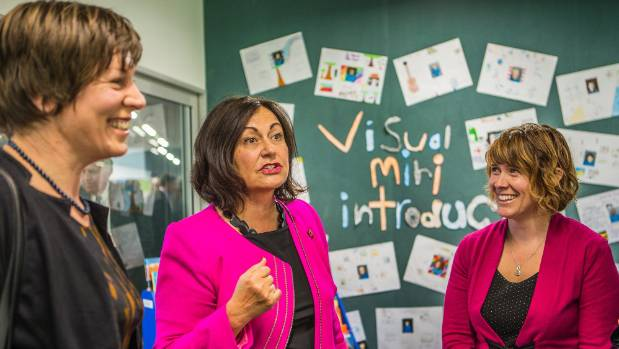 Deputy mayor Sarah Walters (left) with Education Minister Hekia Parata (centre) open a primary school.