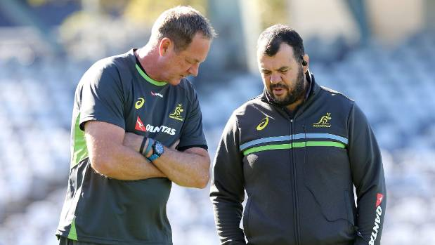 Michael Cheika talks with former All Blacks skills coach Mick Byrne during a Wallabies training session.