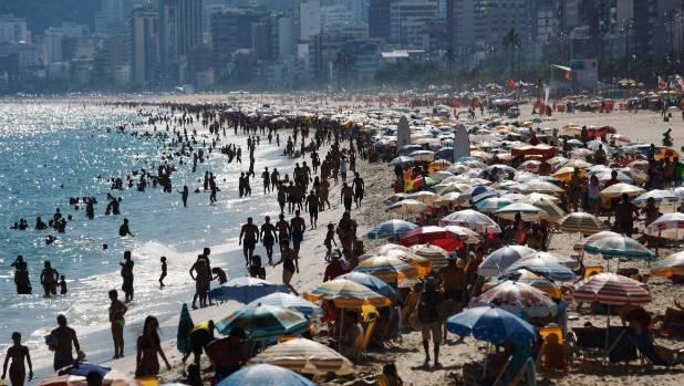 Crowds gather on Ipanema beach.