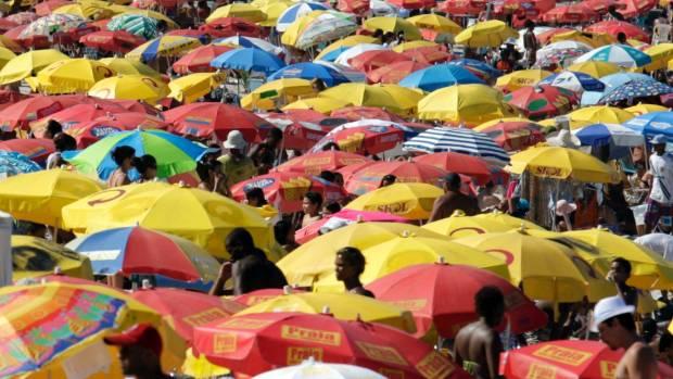 Brazilians and tourists enjoy Copacabana Beach.