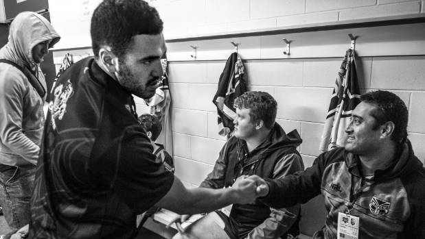 From left, team members Charles Walters, Jarod Kumeroa and Maloni Tuitupou greet each other ahead of the match against ...