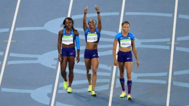 The US women's 4x100m team faced immense pressure as they raced only the clock in a heat by themselves.