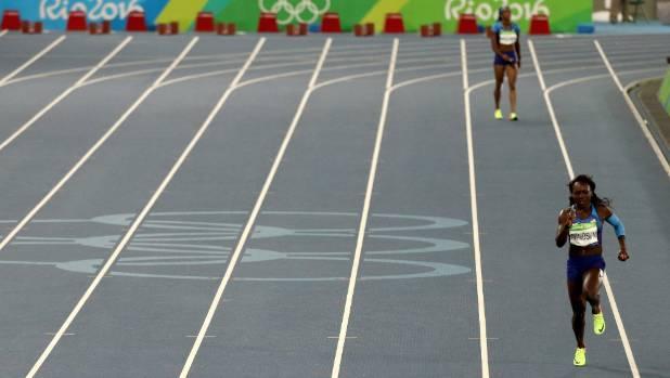 Morolake Akinosun runs her leg of the United States' solo 4x100 relay.