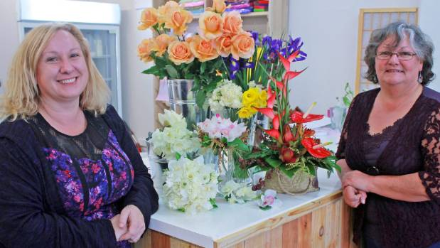 Joanna Reeve and Kerry Mitchell standing with their flowers and upcycled counter.
