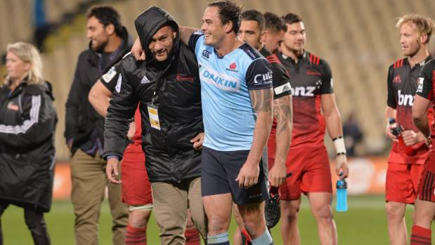 Robbie Fruean, pictured on the left embracing Zac Guildford after the Waratahs met the Crusaders in Christchurch in May, ...