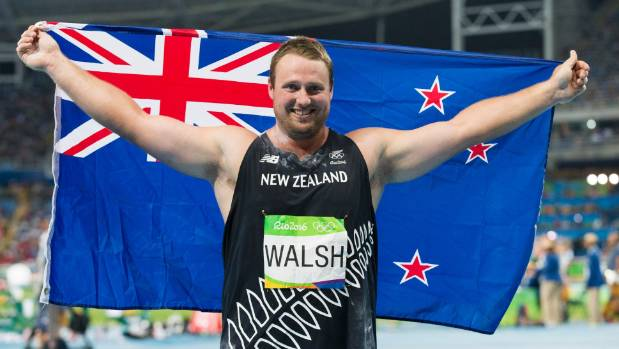 Proud Kiwi Tom Walsh waves the New Zealand flag in Rio after winning bronze in men's Olympic shot put.