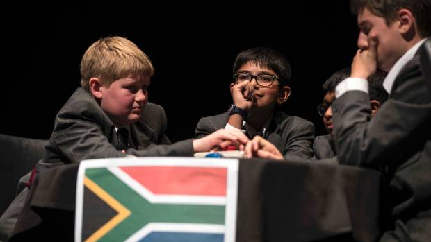 The South African team muse over a brain teaser.