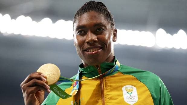 Gold medalist Caster Semenya stands on the podium during the medal ceremony for the Women's 800 metre race.