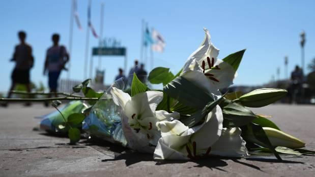 Flowers lie on the Promenade des Anglais, in Nice, where one of more than 80 people were killed by a  French-Tunisian ...
