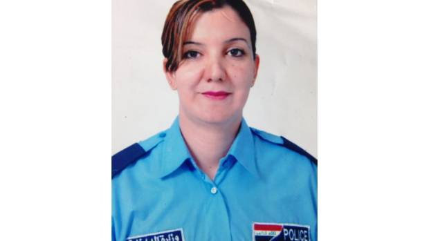 Nadia Saeed in her Iraqi police uniform.