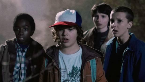 The gang: Caleb McLaughlin as Lucas, Gaten Matarazzo as Dustin, Finn Wolfhard as the leader, Mike, and Millie Bobby ...