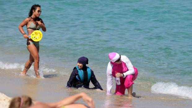 burkini ban fury as french police force woman to remove tunic