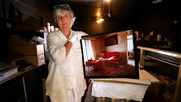 Tikorangi resident Fiona Clark with a portrait she took of 'Peter' in 1988, who was a sufferer of the HIV/AIDS virus. ...