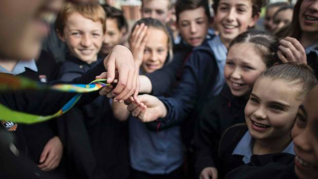 Pupils from Belmont Intermediate in Takapuna get to touch Eliza McCartney's bronze medal from the Rio Olympics.