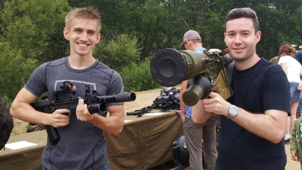 Igor Novikov and Tim McCready at the military open day with a machine gun and grenade launcher.
