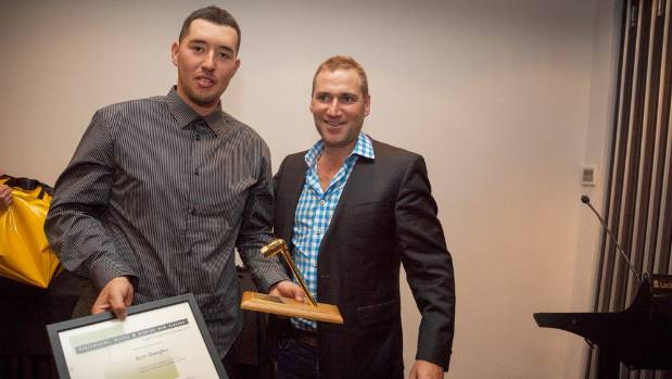 Kurt Douglas receives the trainee scaffolder of the year award from Scaffolding Access and Rigging New Zealand President ...