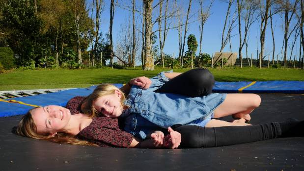 Katja Heise, 18, takes a break to lay in the sun with Niamh O'Sullivan, 6.