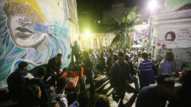 People gather at a samba party on the famed Pedra do Sal in the Port District, near the Olympic Boulevard, in Rio de ...