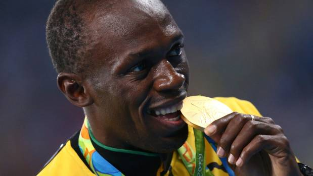 Usain Bolt Celebrates With One Of The Three Gold Medals He Won In Rio