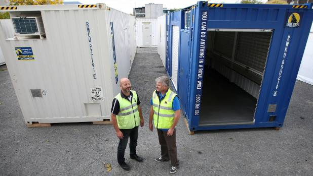 Rick Mills and Paul Creighton from Royal Wolf with containers they are converting for the Christchurch rebuild.