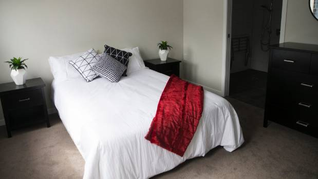 A furnished bedroom at the Wairere Village kaumatua home with a wheelchair accessible bathroom.