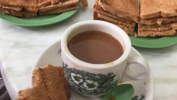 Kaya toast and kopi are the quintessential Singaporean breakfast.
