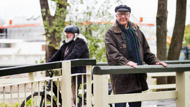 Ken McAnergney, right, blessed the 150-year-old bridge, which runs through Little Hagley Park. Only cyclists and ...