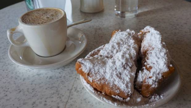 Dredged in icing sugar, the Cafe du Monde beignets are a must.
