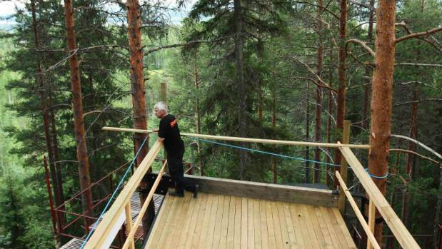 Treehotel co-founder Kent Lindvall on the rooftop balcony of The Cabin on the construction site of Treehotel in the ...