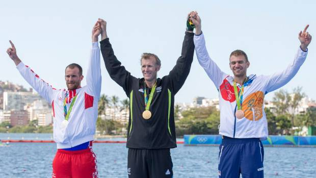 New Zealand's men's single scull gold medallist Mahe Drysdale, centre, with silver medallist Damir Martin of Croatia, ...