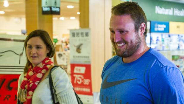 Tom Walsh is welcomed home by partner Dana after returning to Christchurch on Thursday from his latest athletics ...