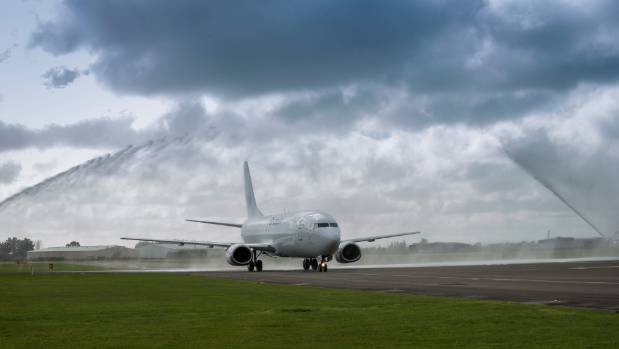 A Freightways Boeing 737 freighter service plane is welcomed to Palmerston North Airport.