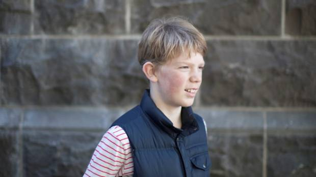 Harry Hampton, 11, a member of the Wellington quiz-winning team, will read anywhere, any time.