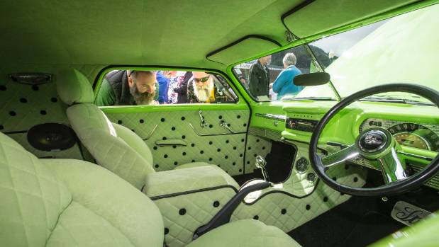 Brian Smith and Grant Bowyer check out the interior of this classic car at the 2016 Aroha Cruise In.
