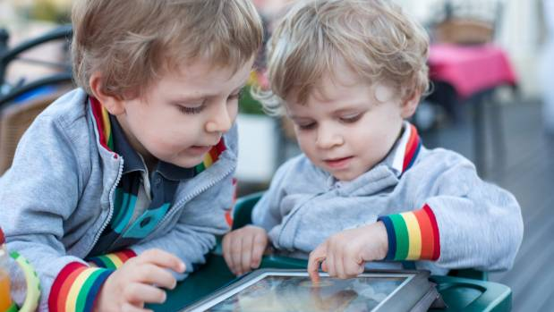 Parents engaging with their children in screen time can help them get more from the experience, researchers Alicia ...