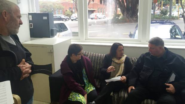 Beneficiaries of the Port Nicholson Block Settlement Trust demand answers from trustee Sam Kahui, right, about the sale ...