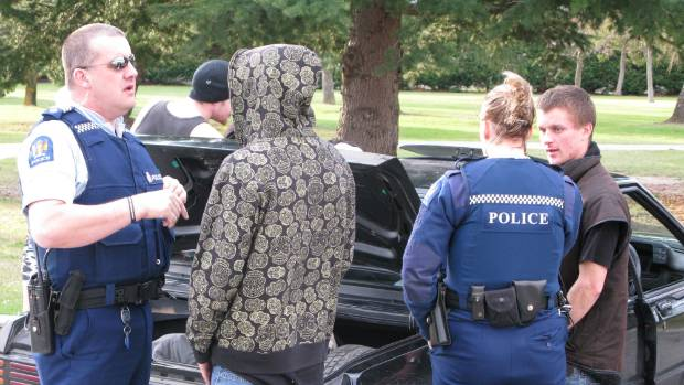 Police talk to a carload of youngsters during the Alexandra Blossom Festival in 2010.